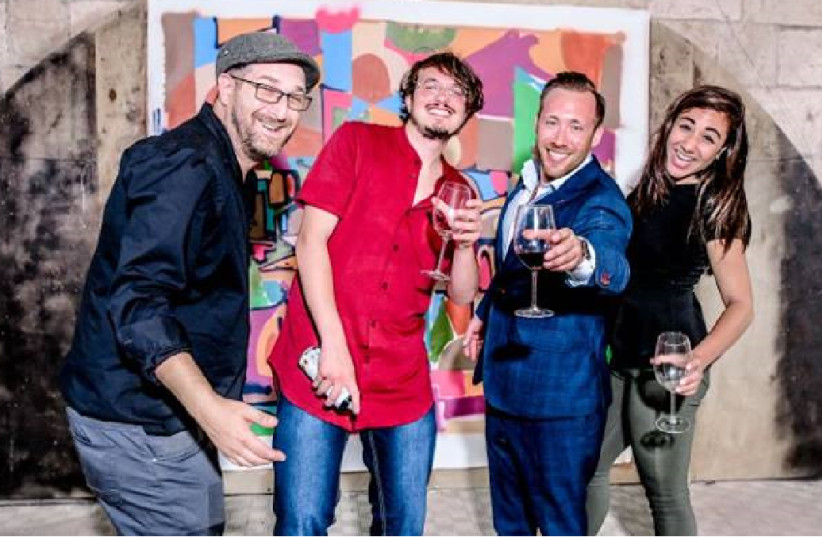 The Wine on the Vine crew poses at their event in Jerusalem last month. (photo credit: Courtesy)