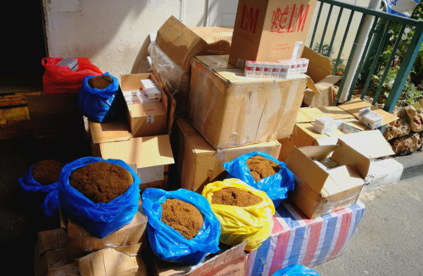 Captured counterfeit tobacco and cigarettes (photo credit: DEFENSE MINISTRY)