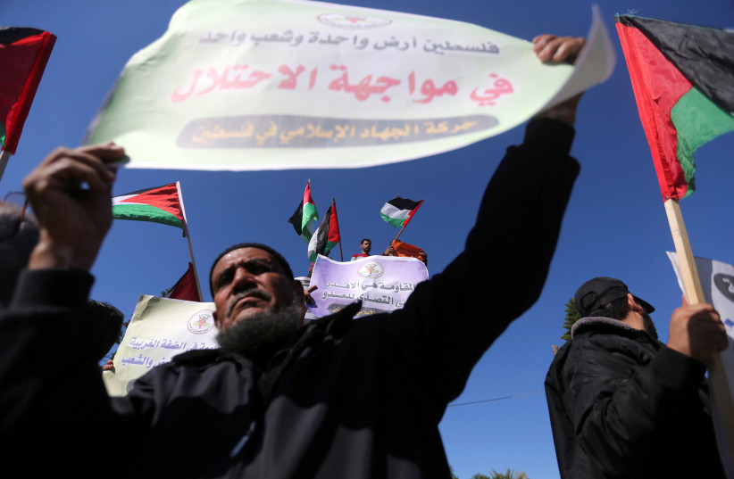 Palestinians take part in a protest calling on Hamas and Fatah factions to conclude the reconciliation, in Gaza city December 3, 2017 (photo credit: REUTERS/IBRAHEEM ABU MUSTAFA)