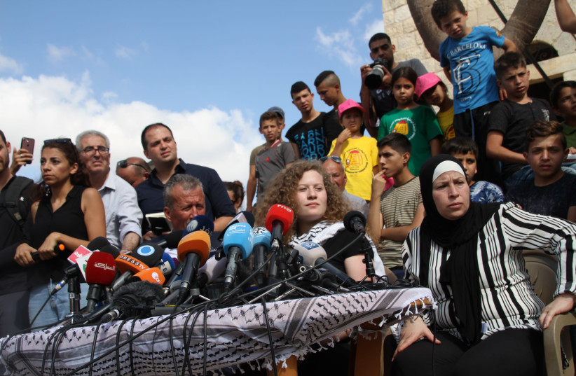 Ahed Tamimi next to her mother (R) Bassam and father Bassam (L)  (photo credit: TOVAH LAZAROFF)