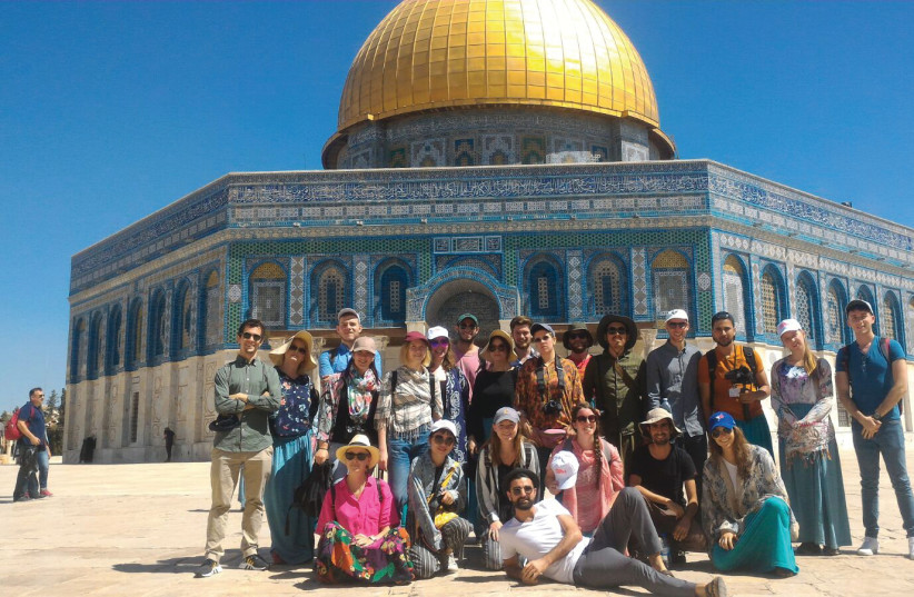 The participants of the 2018 Jerusalem Film Workshop, with the Dome of the Rock in the background (photo credit: Courtesy)