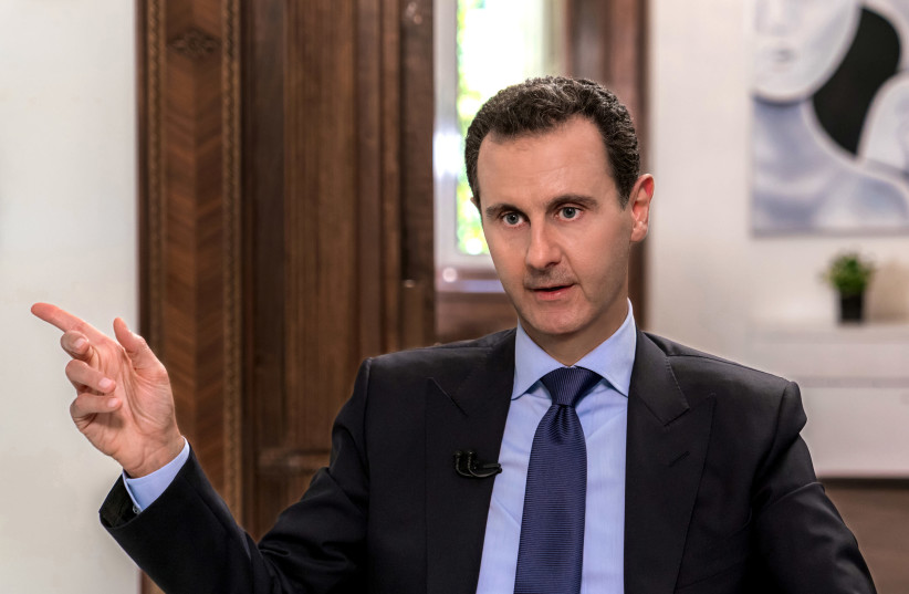 Syrian President Bashar Assad speaks during an interview with Russian television channel NTV, in Damascus, Syria in this handout released on June 24, 2018.  (photo credit: SANA/REUTERS)
