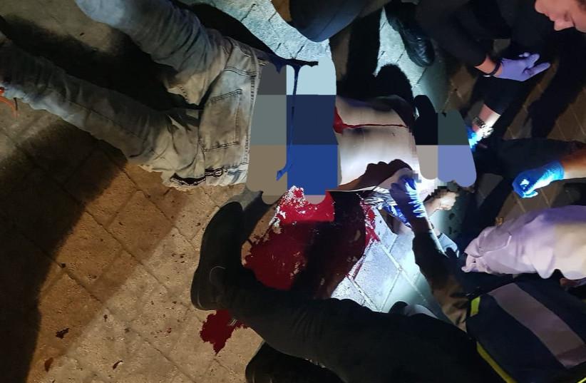 Police find stabbing victim lying in pool of blood on Finn Street in south Tel Aviv (photo credit: ISRAEL POLICE)