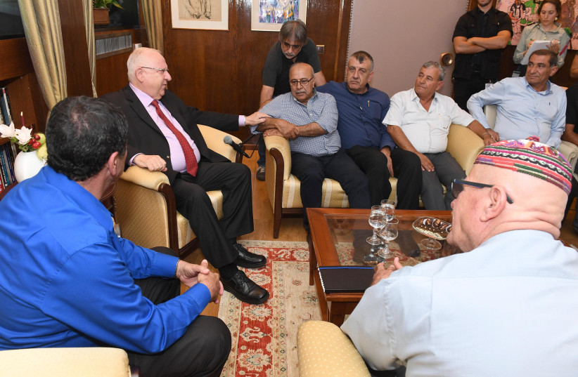 PRESIDENT REUVEN RIVLIN with Rafik Halabi (seated, at Rivlin's left) and other Druze leaders (photo credit: MARK NEYMAN / GPO)