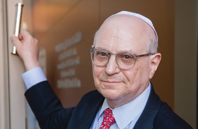 DR. LARRY NORTON affixes a mezuzah Tuesday at the new Negev cancer center established in his name.  (photo credit: RACHEL DAVID)