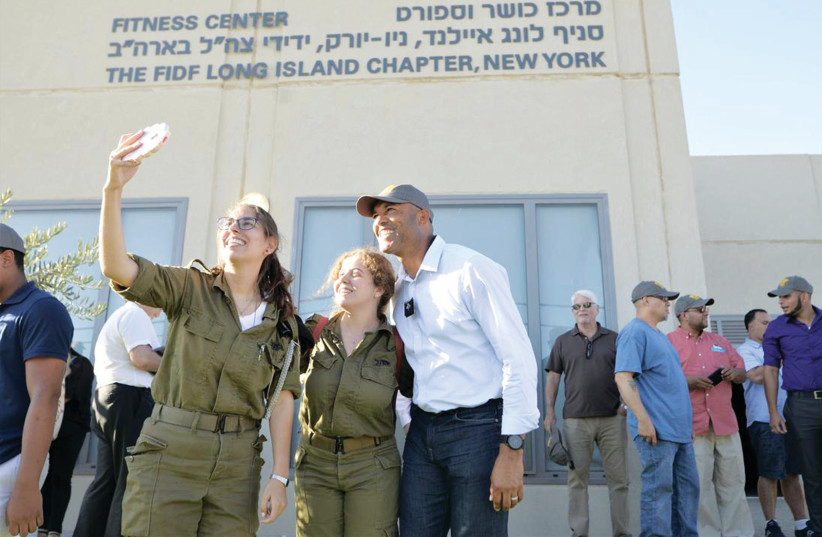 A COUPLE of Israeli soldiers take a selfie with baseball legend Mariano Rivera during his visit this week to the Michve Alon IDF base in Northern Israel. (photo credit: REUTERS)