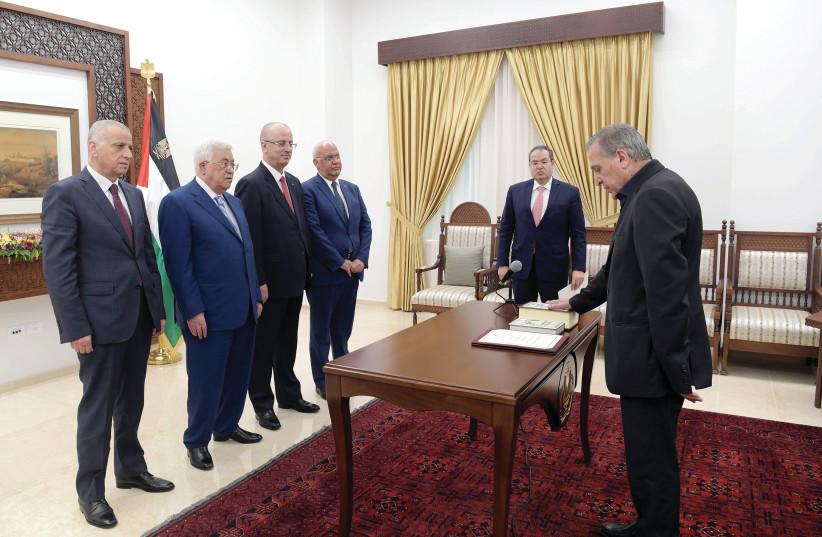 PALESTINIAN DEPUTY PRIME MINISTER Nabil Abu Rudeineh is sworn in before President Mahmoud Abbas in Ramallah (photo credit: PALESTINIAN PRESIDENT OFFICE VIA REUTERS)