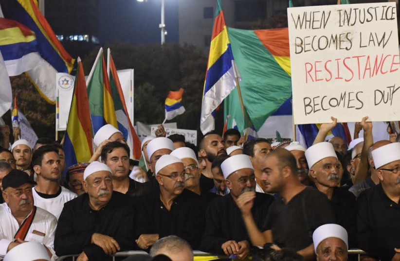 Tens of thousands protest in Tel Aviv along with the Druze against the recently passed Nation-State Law (photo credit: AVSHALOM SASSONI/ MAARIV)