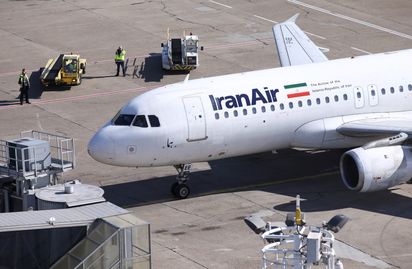 An IranAir Airbus A320 passengers aircraft parks after landing at Belgrade's Nikola Tesla Airport, Serbia, March 13, 2018 (photo credit: MARKO DJURICA / REUTERS)