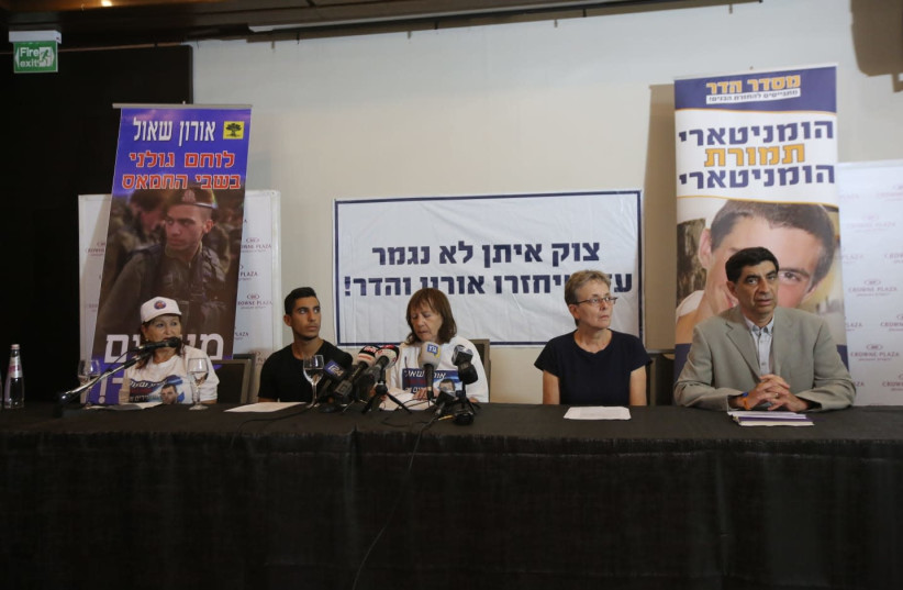 The families of Hadar Goldin and Oron Shaul at a press conference, August 5, 2018 (photo credit: MARC ISRAEL SELLEM/THE JERUSALEM POST)