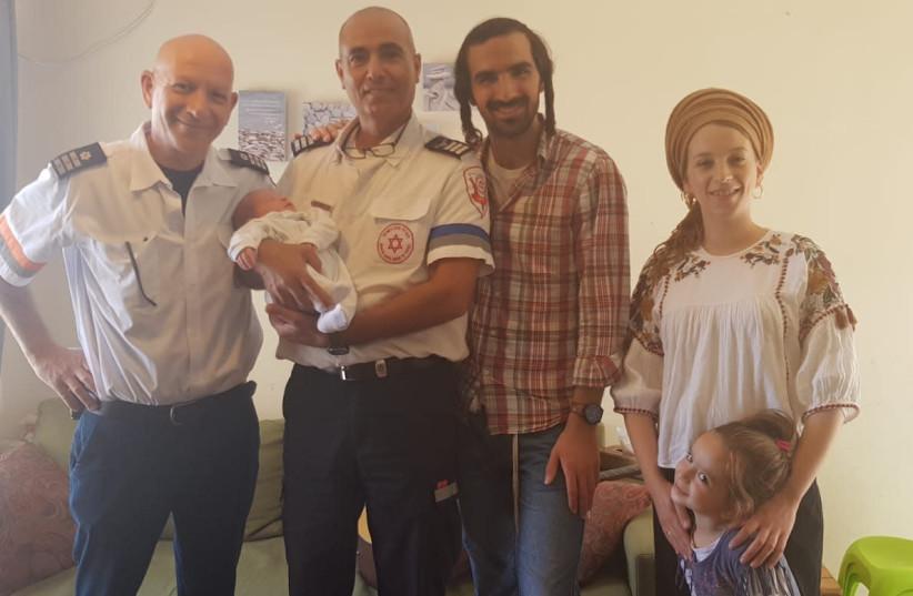 Marsiano family with MDA paramedics after playing guitar in the ambulance (photo credit: MDA)