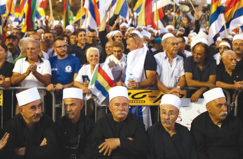 Druze leaders partake in the protest against the Nation-State Law in Tel Aviv, August 2018 (photo credit: CORINNA KERN/REUTERS)
