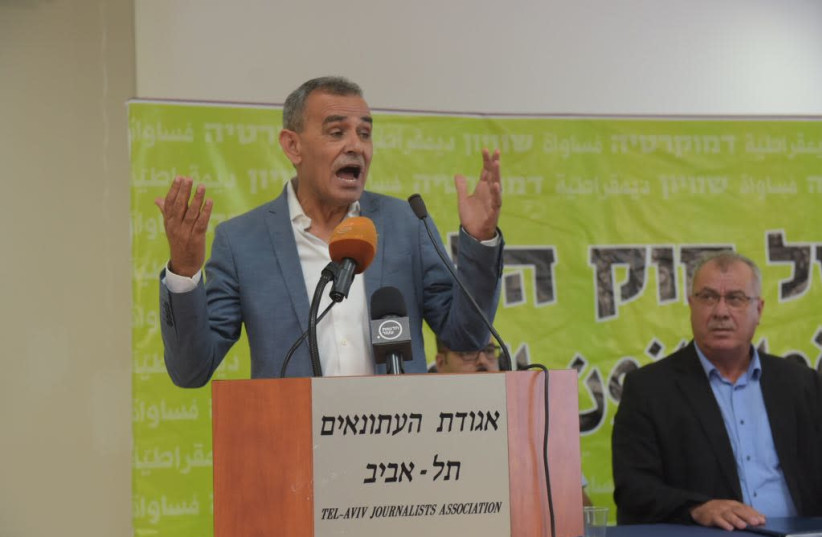 MK Jamal Zahalka speaking at a Tel Aviv press conference against the Nation-State Law, August 7, 2018 (photo credit: AVSHALOM SASSONI/ MAARIV)