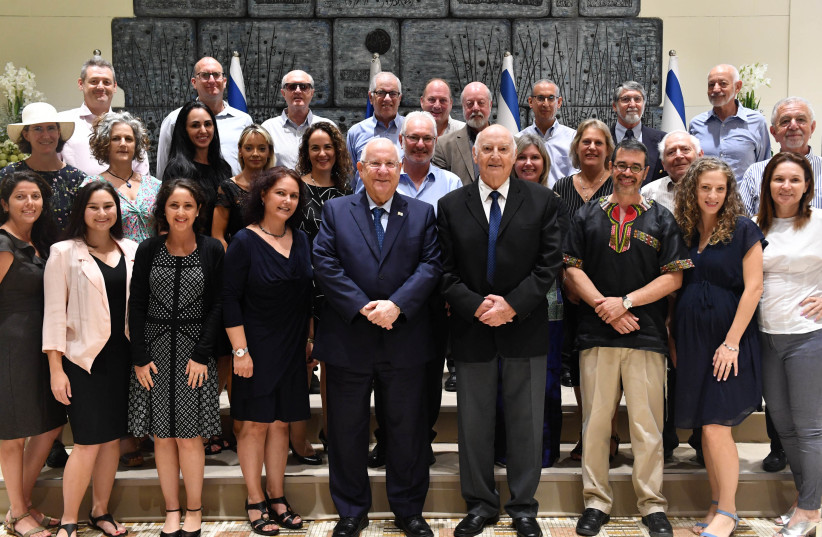 President Reuven Rivlin with members of the Telfed deleqation. Rivlin is flanked by Telfed Chairwoman Batya Shmukler and former Telfed chairman Hertzel Katz.  (photo credit: KOBI GIDEON/GPO)