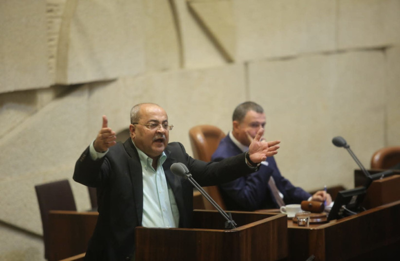 MK Ahmad Tibi (Joint List)  at the Knesset during a discussion on the Nation-State Law August 8, 2018. (photo credit: MARC ISRAEL SELLEM/THE JERUSALEM POST)