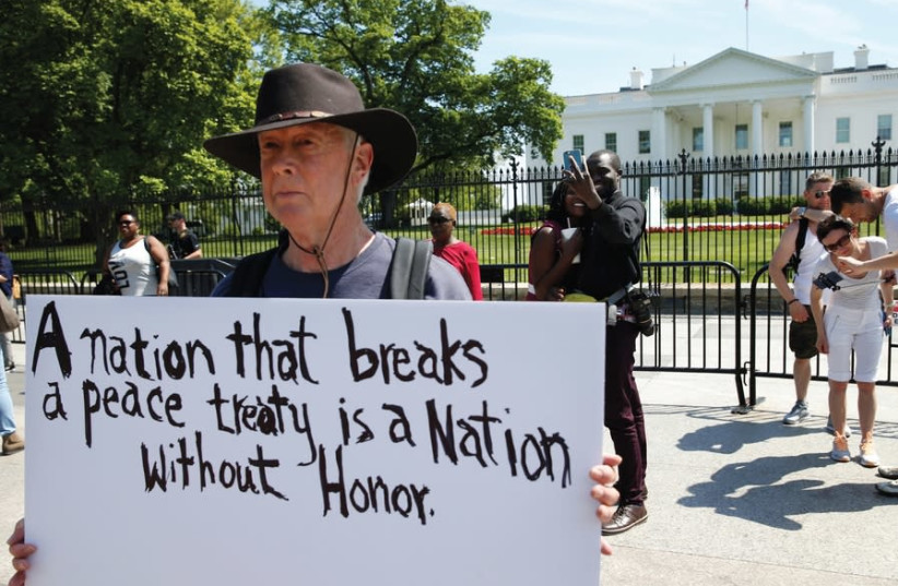 A PROTESTER makes his feelings known outside the White House as President Donald Trump announced the US withdrawal from the Iran deal, in Washington on May 8, 2018 (photo credit: REUTERS)