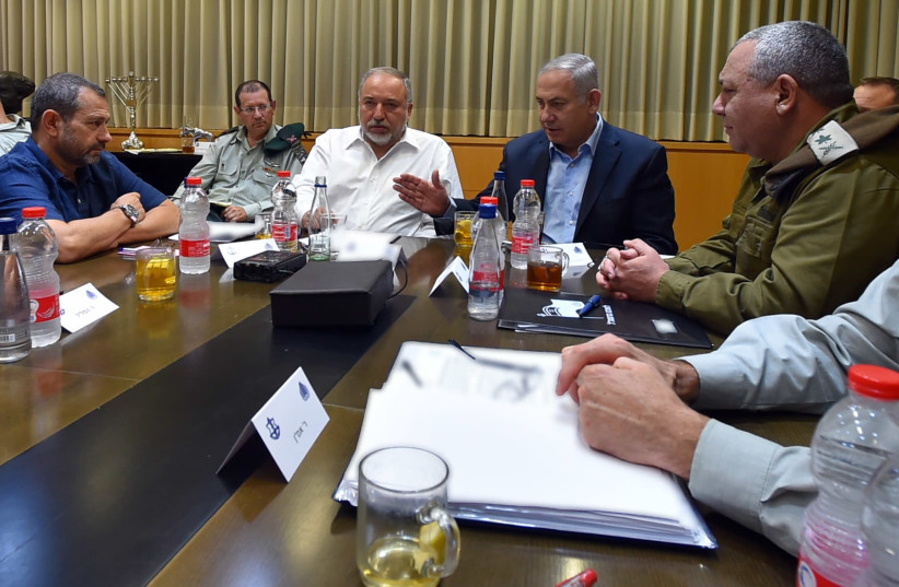 Prime Minister Benjamin Netanyahu, Minister of Defense Avigdor Liberman, Chief of Staff Eizenkot and others at urgent security cabinet meeting, Aug 9 2018 (photo credit: ARIEL HERMONI / DEFENSE MINISTRY)
