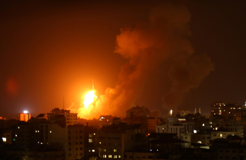 An explosion is seen during an Israeli air strike in Gaza City August 8, 2018.  (photo credit: STRINGER/ REUTERS)