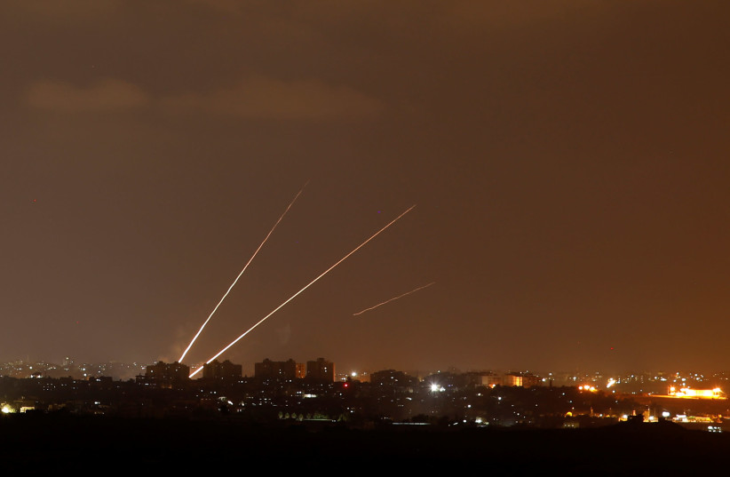 Streaks of light are pictured as rockets are launched from the northern Gaza Strip towards Israel, as seen from Sderot, Israel August 8, 2018.  (photo credit: AMIR COHEN - REUTERS)