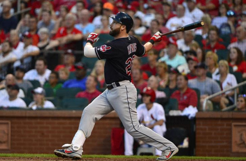 Cleveland Indians second baseman Jason Kipnis (22) hits a one run single off of St. Louis Cardinals starting pitcher Jack Flaherty (not pictured) during the third inning of a baseball game at Busch Stadium (photo credit: JEFF CURRY/USA TODAY SPORTS/HANDOUT VIA REUTERS)