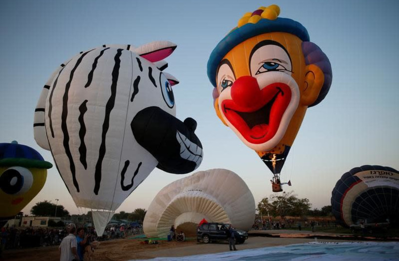 Hot air balloons are prepared before they take flight during a two-day international hot air balloon festival in Eshkol Park near the southern city of Netivot, Israel July 22, 2016. (photo credit: AMIR COHEN/REUTERS)
