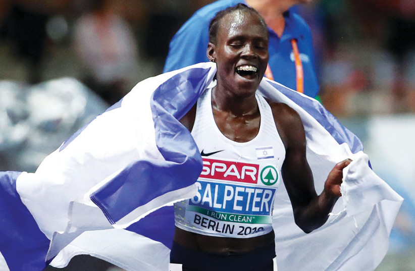 Lonah Chemtai Salpeter of Israel celebrates after winning a gold medal in the 10,000 meters at the European Championships in Berlin (photo credit: REUTERS)