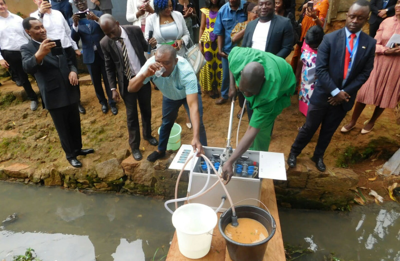 A demonstration of the NUF purification system in Cameroon to government officials, local journalists and representatives from Israel (photo credit: Courtesy)
