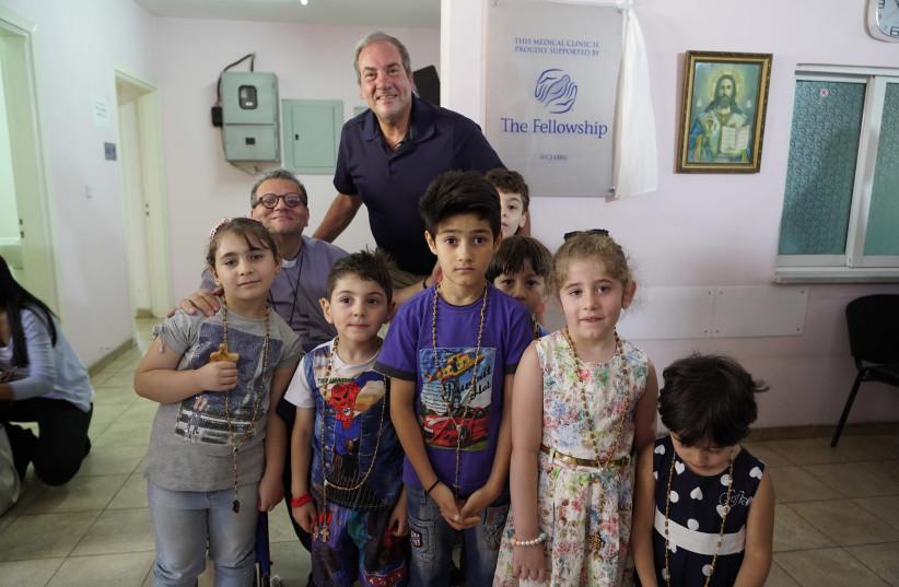 Rabbi Yechiel Eckstein visiting an IFCJ-sponsored medical clinic in Amman that treats Christian refugees (photo credit: Courtesy)