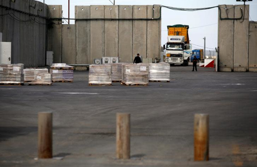 A truck parks next to a security barrier inside the Kerem Shalom border crossing terminal between Israel and Gaza Strip January 16, 2018 (photo credit: AMIR COHEN/REUTERS)