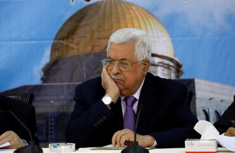 Palestinian Authority President Mahmoud Abbas attends the meeting of the Palestinian Central Council, in Ramallah, in the West Bank August 15, 2018 (photo credit: REUTERS/MOHAMAD TOROKMAN)