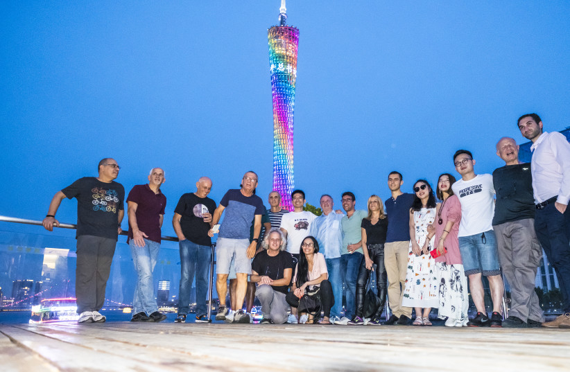 THE ISRAELI JOURNALISTS pose for a photo with their Chinese hosts  at the Canton Tower (photo credit: XIALONG ZHUANG)