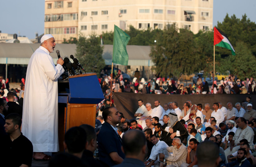 Palestinian Hamas Chief Ismail Haniyeh gives a speech after prayers on the first day of Eid al-Adha festival, in Gaza City August 21, 2018 (photo credit: IBRAHEEM ABU MUSTAFA / REUTERS)