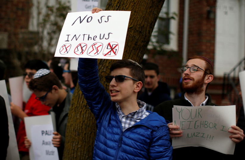Students from Rambam Mesivta-Maimonides High School protest outside the home of Jakiw Palij in the Queens borough of New York City, US, April 24, 2017 (photo credit: MIKE SEGAR / REUTERS)