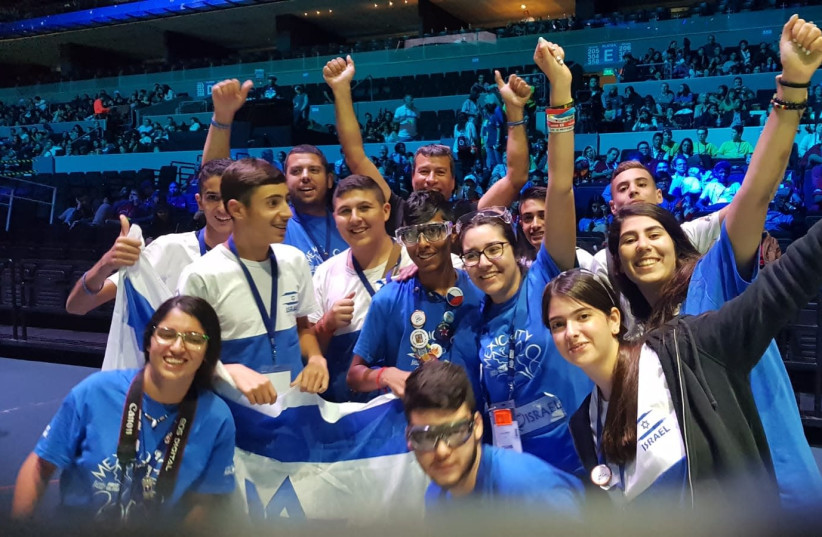 Team Israel celebrates victory in the arena where the challenge took place.  (photo credit: COURTESY OF ITAY TURGEMAN)