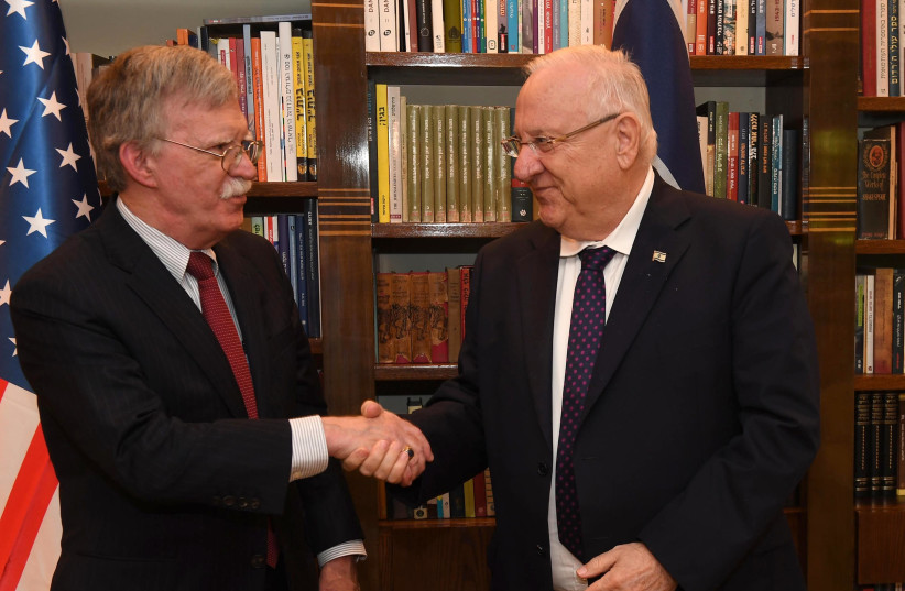 Reuven Rivlin and John Bolton shake hands in Jerusalem August 21, 2018 (photo credit: MARK NEYMAN/GPO)