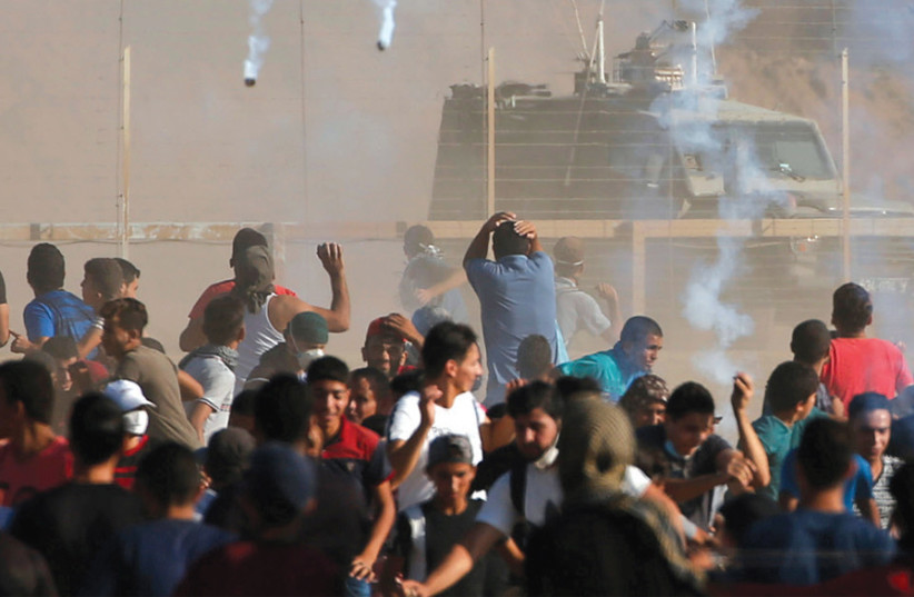 gaza protest (photo credit: MOHAMMED SALEM/REUTERS)