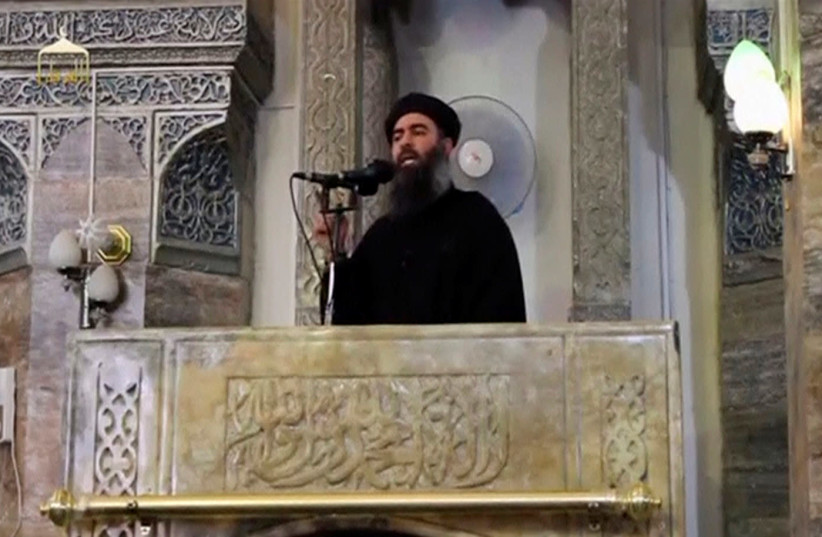 A man purported to be the reclusive leader of the militant Islamic State Abu Bakr al-Baghdadi has made what would be his first public appearance at a mosque in the centre of Iraq's second city, Mosul, according to a video recording posted on the Internet on July 5, 2014, in this still image taken fr (photo credit: REUTERS FILE PHOTOS)