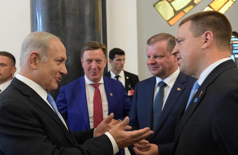Prime Minister Benjamin Netanyahu (L) with Latvian Prime Minister Māris Kučinskis Lithuanian Prime Minister Saulius Skvernelis and Estonian Prime Minister Jüri Ratas in Vilnius.     (photo credit: AMOS BEN-GERSHOM/GPO)