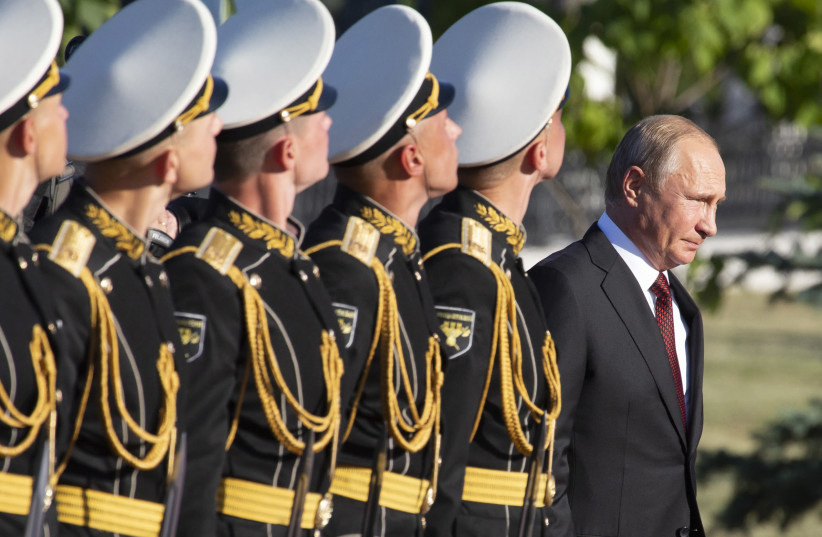 Russian President Vladimir Putin arrives for a wreath laying ceremony to commemorate the 75th anniversary of the battle of Kursk in World War Two, in Kursk, south of Moscow, Russia August 23, 2018 (photo credit: ALEXANDER ZEMLIANICHENKO/POOL VIA REUTERS)