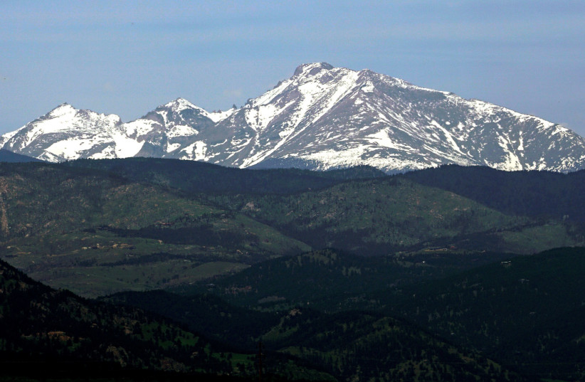 Long's Peak in Rocky Mountain National Park is seen from Boulder, Colorado June 3, 2016 (photo credit: RICK WILKING / REUTERS)