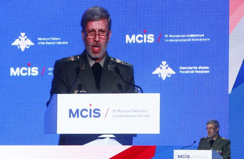 Iranian Defense Minister Amir Hatami delivers a speech during the annual Moscow Conference on International Security (MCIS) in Moscow, Russia April 4, 2018 (photo credit: REUTERS/SERGEI KARPUKHIN)