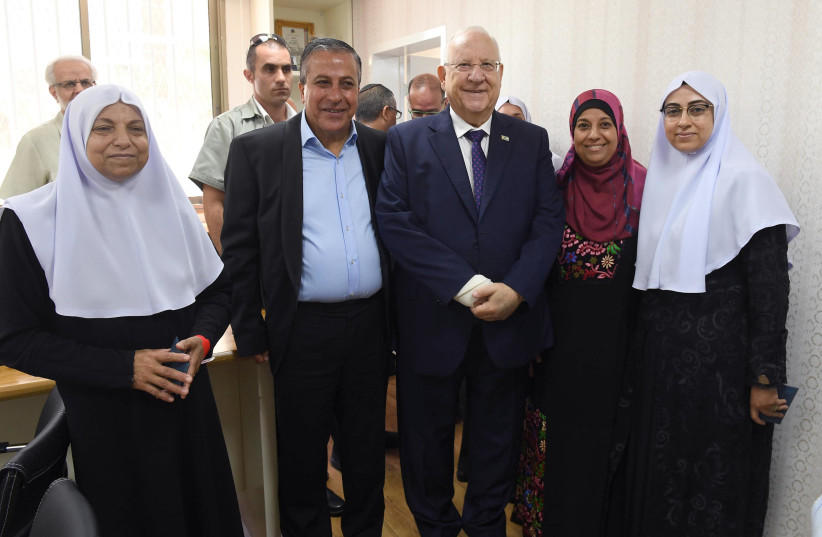 President Reuven Rivlin next to the mayor of Kafr Qasim Adel Badir alongside members of the Kafr Qasim Council of Women (photo credit: MARC NEYMAN/GPO)