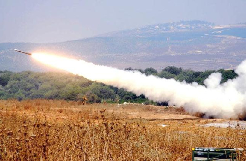An artillery unit launches a surface-to-surface missile towards southern Lebanon from a position in northern Israel July 16, 2006, in this handout picture released by the Israeli Defense Forces July 17, 2006 (photo credit: REUTERS/AVIV DIVON/HANDOUT/IDF)