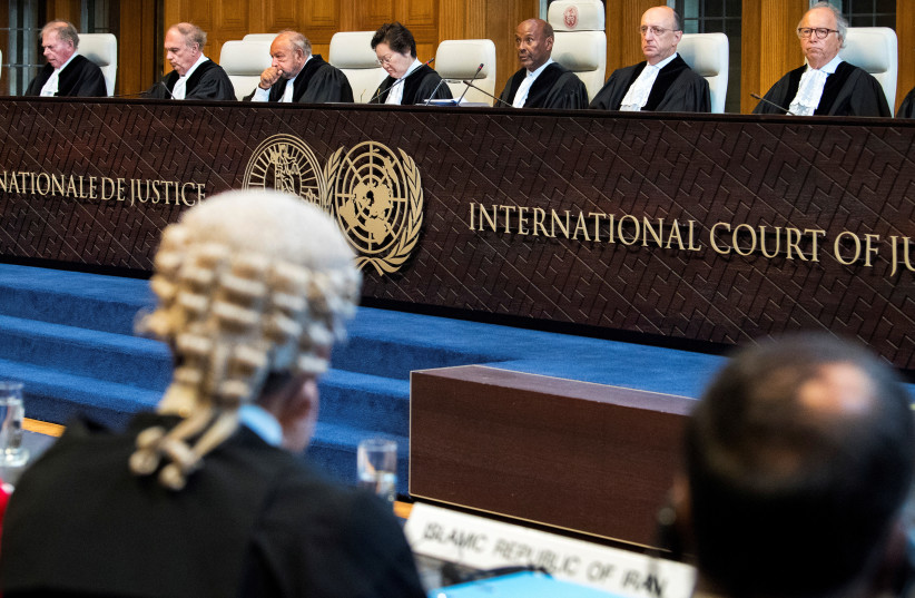 Members of the International Court of Justice attend a hearing for alleged violations of the 1955 Treaty of Amity between Iran and the U.S., at the International Court in The Hague, Netherlands August 27, 2018. (photo credit: REUTERS/PIROSCHKA VAN DE WOUW)