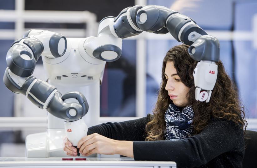 Human - robot collaboration (August 20, 2018). (photo credit: ABB ROBOTICS)