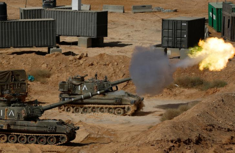 An Israeli mobile artillery unit fires during a combined forces drill in Shizafon military base, near Eilat in southern Israel June 7, 2016 (photo credit: AMIR COHEN/REUTERS)