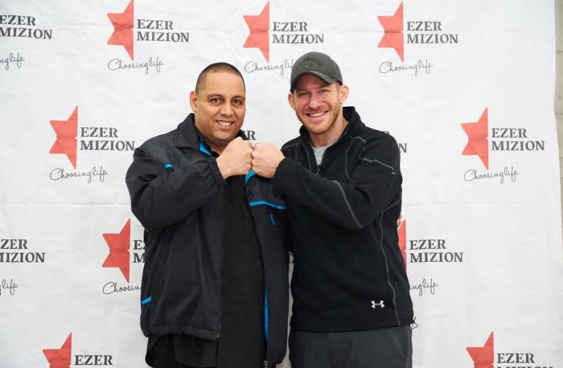 Stu Schwartz, leukemia patient, meets David Levi, the bone marrow donor that saved his life, 2018 (photo credit: EZER MIZION / COURTESY)