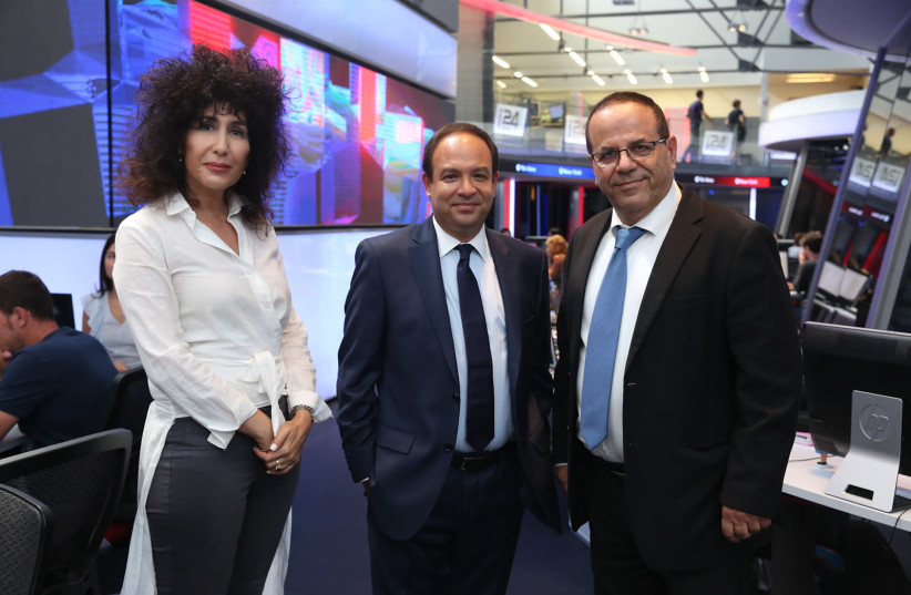 COMMUNICATIONS MINISTER Ayoub Kara (right), i24NEWS CEO Frank Melloul (center) and Yifat Ben Hay-Segev of Israel's Broadcasting Council at the network's offices in Jaffa on Wednesday Aug 29 2018 (photo credit: IDAN MALKA)