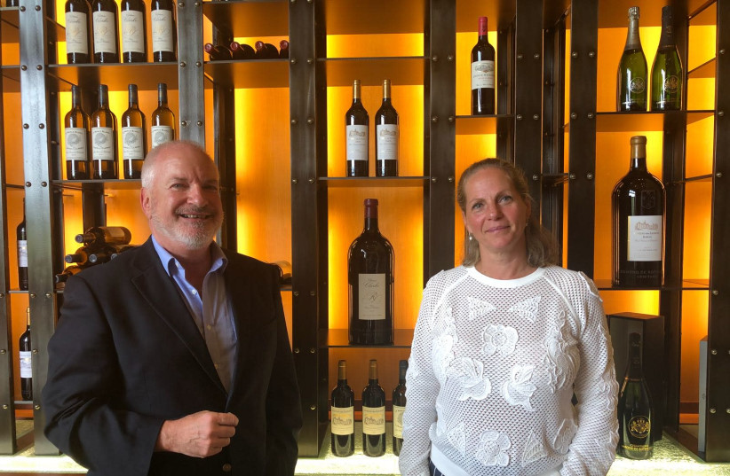 Baroness Ariane de Rothschild and Adam Montefiore standing in front of the EDR Heritage wines (photo credit: Courtesy)