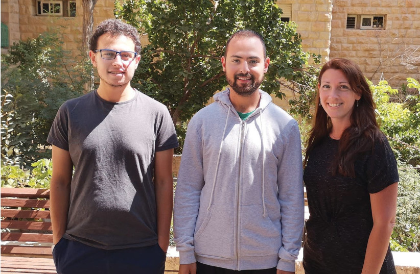Students Joel Collick, Ezra Rosenblum and Anna stand in the courtyard of the Ulpan Etzion. (photo credit: Courtesy)